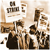 Older photo of men holding signs on strike.